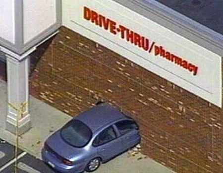 car hit pharmacy drive through